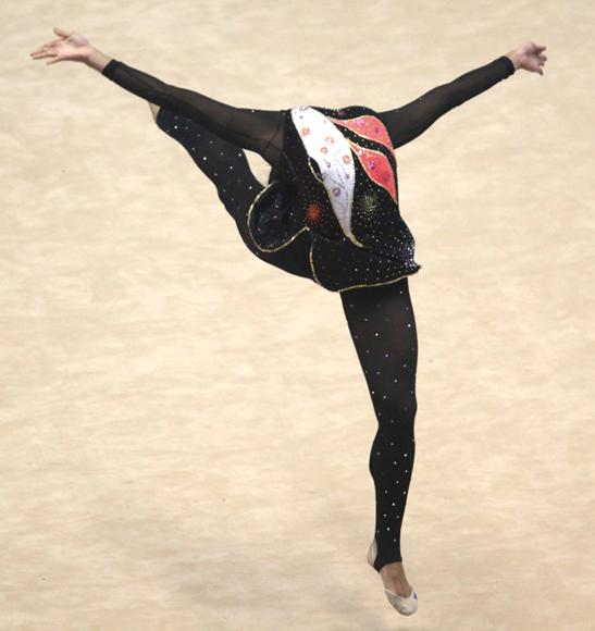Venezuela's Katherinh Arias performs during the individual ball competition of the Rhythmic Gymnastics at the South American Games in Medellin March 28, 2010. (REUTERS/Jose Miguel Gomez)
