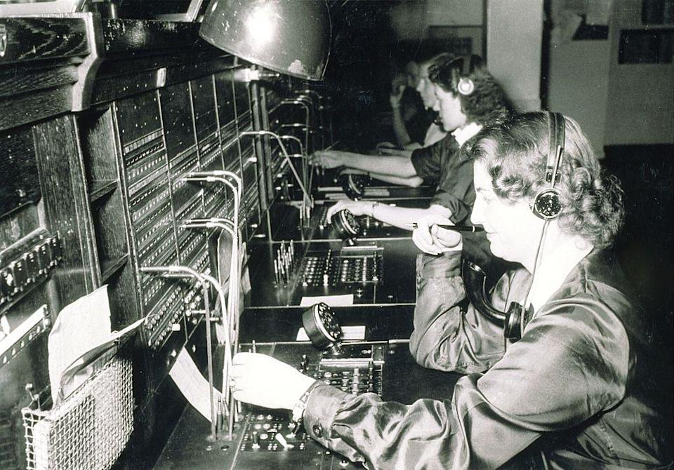 <p>A row of switchboard operators connect calls by inserting a pair of phone plugs into the corresponding jacks appropriate for the call. While switchboard operators started off as a male-dominated role, employers soon realized the benefit of hiring women as they were patient, polite, and had more soothing voices (not to mention, they cost less to hire at the time). </p>
