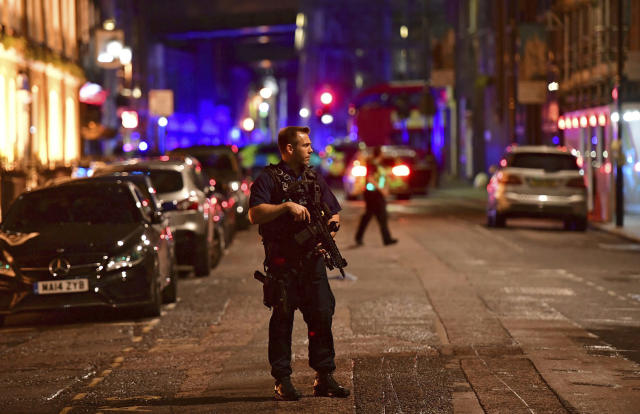 <p>An armed policeman stands on Borough High Street as police are dealing with an incident on London Bridge in London, Saturday, June 3, 2017. Witnesses reported a vehicle hitting pedestrians and injured people on the ground. (Dominic Lipinski/PA via AP) </p>