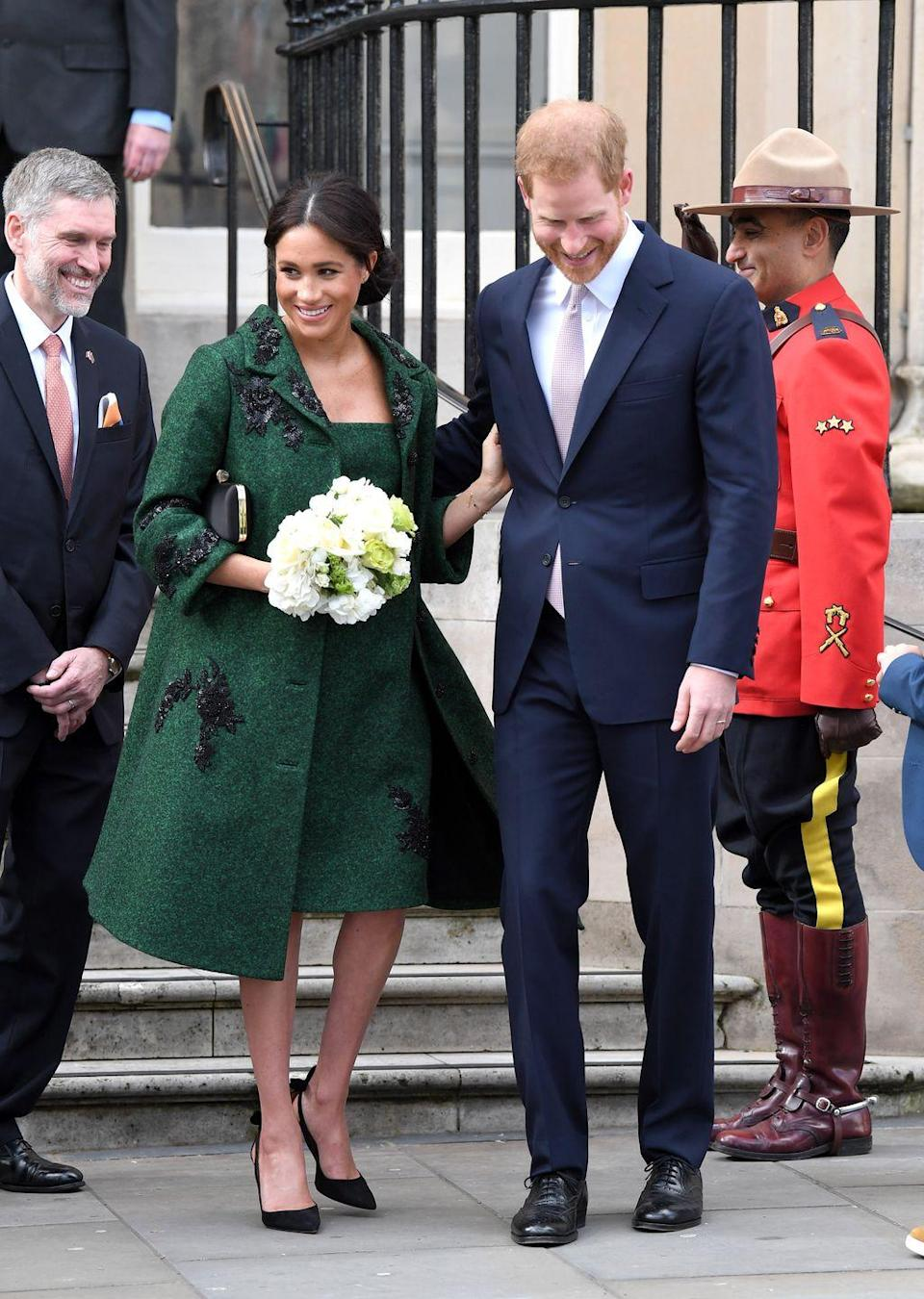 <p>Prince Harry and Meghan Markle attended a Commonwealth Youth Event at Canada House hand in hand. A very happy Meghan received flowers from a young fan. </p>