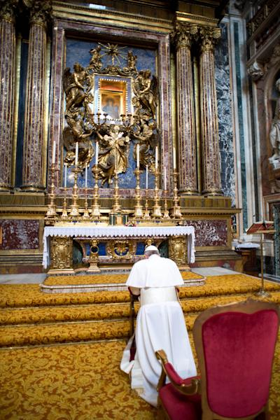 \In this photo provided by the Vatican newspaper L'Osservatore Romano, Pope Francis kneels in prayer in front of the icon of the Virgin Mary inside St. Mary Major Basilica, in Rome, Thursday, March 14, 2013. Pope Francis opened his first morning as pontiff by praying Thursday at Rome's main basilica dedicated to the Virgin Mary, a day after cardinals elected him the first pope from the Americas in a bid to revive a Catholic Church in crisis and give it a preacher with a humble touch. (AP Photo/L'Osservatore Romano, ho)