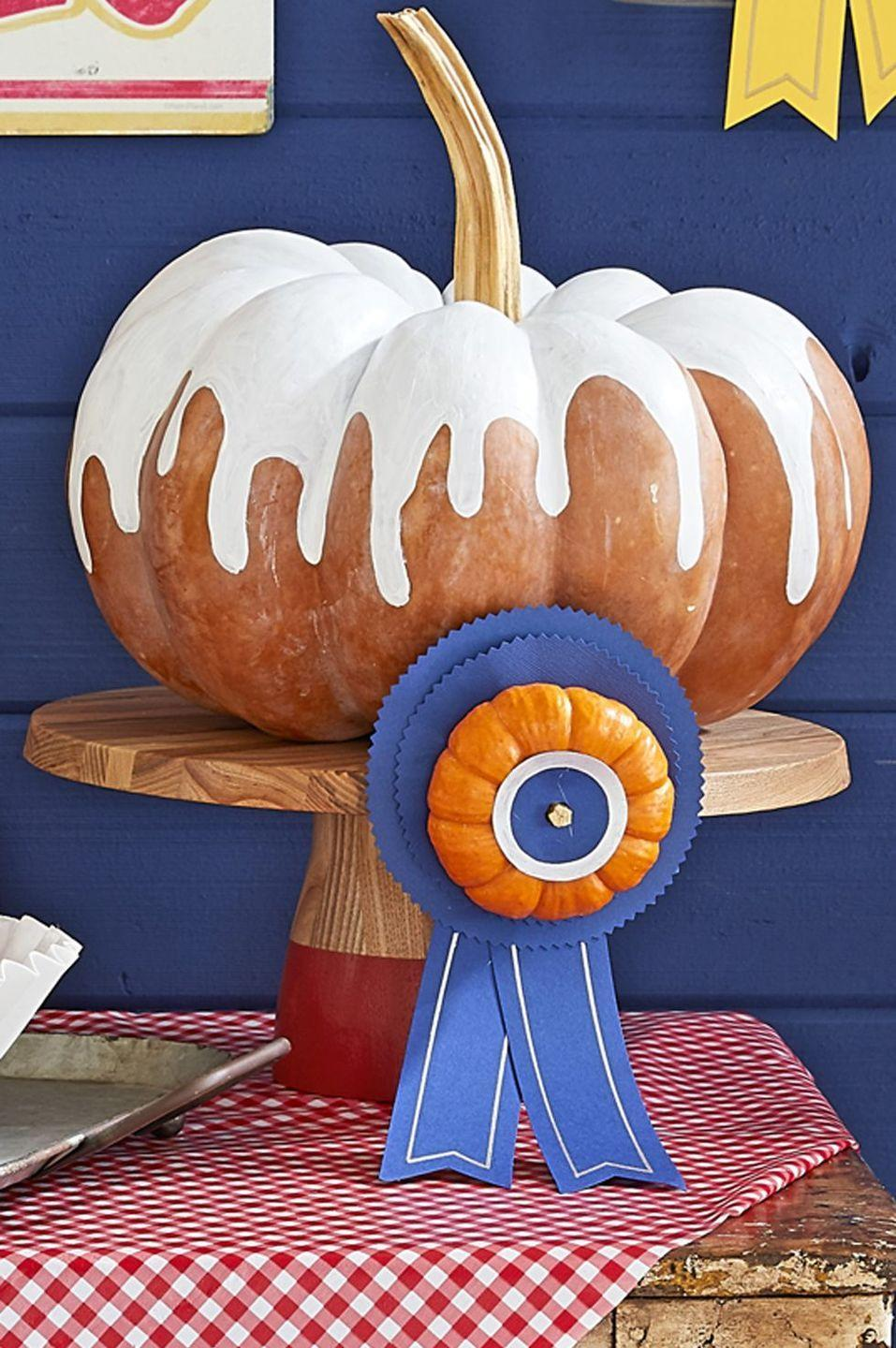 """<p>Your sweet tooth will take center stage with this painted pumpkin. And if you want to make yours look like pumpkin pie, then try to find a pumpkin with a rich rustic color as opposed to bright orange (or slap on a coat of rust-colored paint, if all else fails). </p><p><em><a href=""""https://www.countryliving.com/diy-crafts/g1363/painted-pumpkins/"""" rel=""""nofollow noopener"""" target=""""_blank"""" data-ylk=""""slk:Get the tutorial at Country Living »"""" class=""""link rapid-noclick-resp"""">Get the tutorial at Country Living »</a></em></p>"""