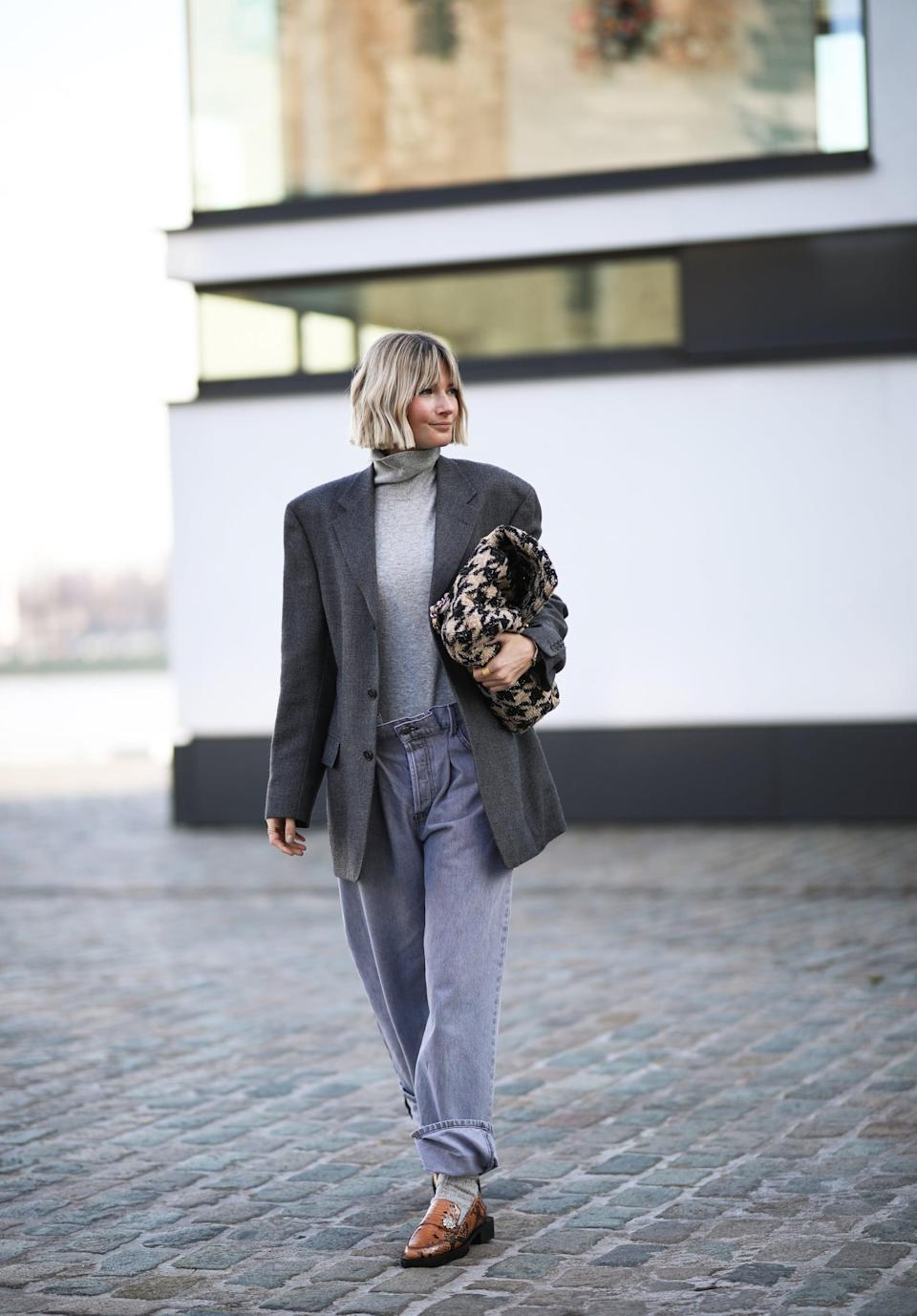 <p>Give baggy jeans a professional look by pairing them with a structured blazer and loafers.</p>