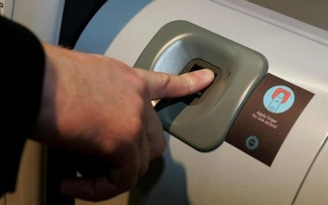 biometric fingerprint scanning - heathrow airport - Credit: Tim Ockenden/PA