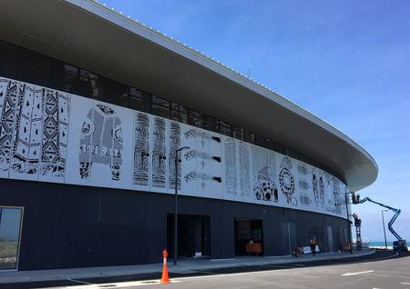 Art panels are seen on a facade of the APEC Haus building in Port Moresby, Papua New Guinea, August 10, 2018, in this picture obtained by Reuters on October 25, 2018 from social media. Jim Fitzpatrick Architects/via REUTERS