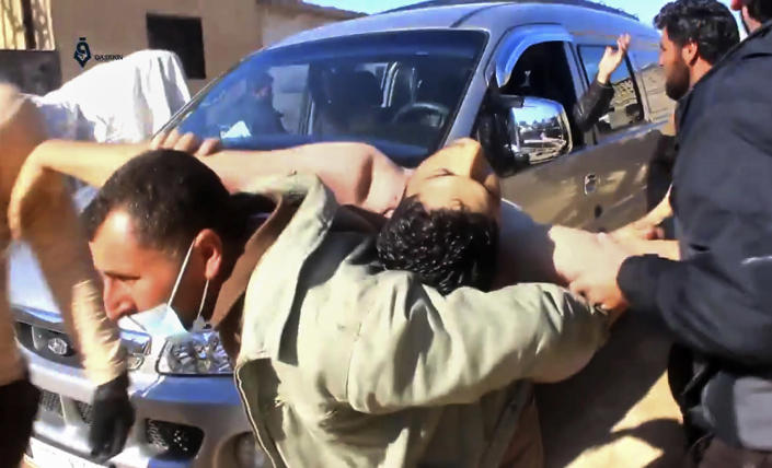 <p>This frame grab from video provided on Tuesday April 4, 2017, by Qasioun News Agency, that is consistent with independent AP reporting, shows a Syrian man carrying a man on his back who has suffered from a suspected chemical attack, in the town of Khan Sheikhoun, northern Idlib province, Syria. The suspected chemical attack killed dozens of people on Tuesday, Syrian opposition activists said, describing the attack as among the worst in the country's six-year civil war. (Qasioun News Agency, via AP) </p>