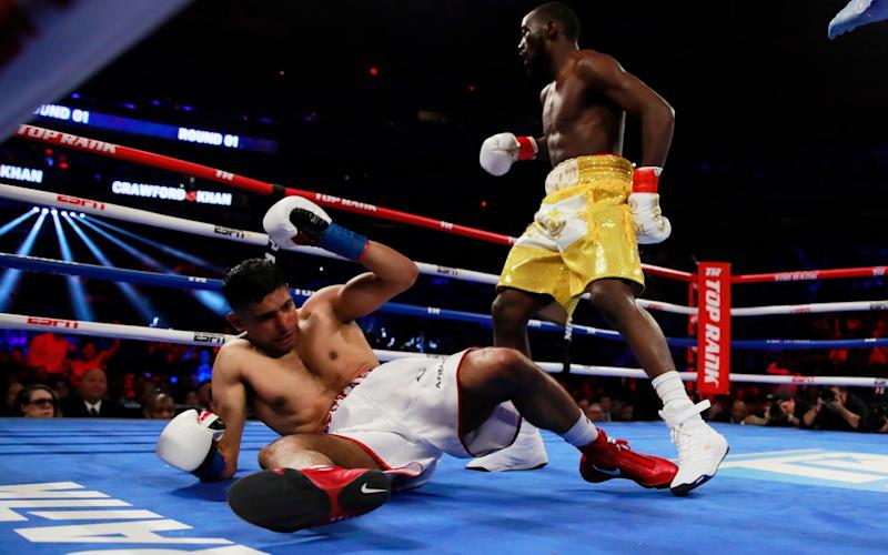 Amir Khan collapses to the floor - Action Images via Reuters