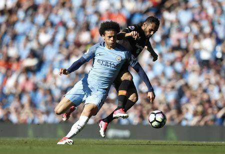 Britain Football Soccer - Manchester City v Hull City - Premier League - Etihad Stadium - 8/4/17 Manchester City's Leroy Sane in action with Hull City's Ahmed Elmohamady Action Images via Reuters / Ed Sykes Livepic
