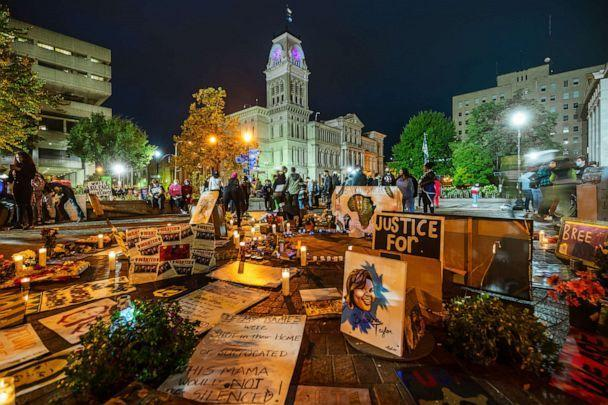 PHOTO: Demonstrators and members of the Black Women's Collective gather around the Breonna Taylor memorial at Jefferson Square Park on Oct. 3, 2020, in Louisville, Ky. (Jon Cherry/Getty Images)