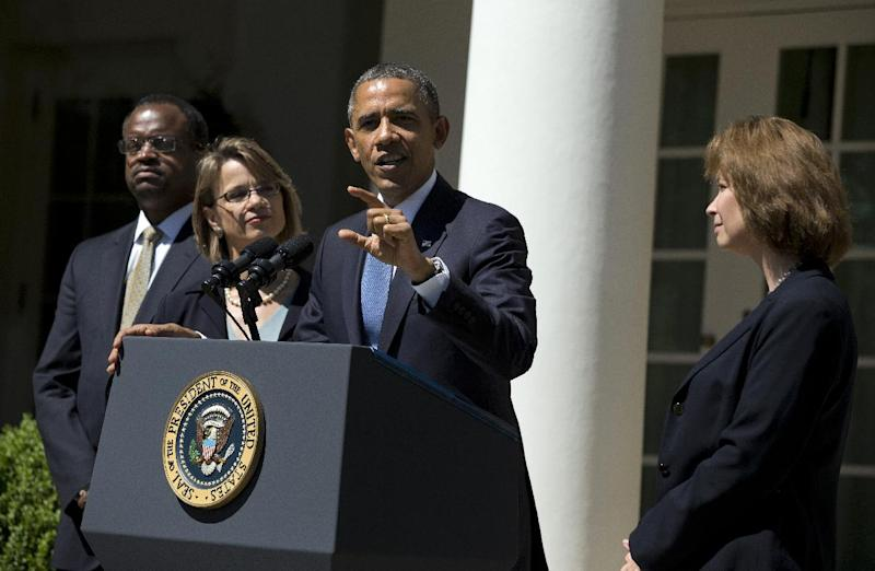 President Barack Obama gestures while speaking in the Rose Garden of the White House in Washington, Tuesday, June 4, 2013, to announce the nominations of, from left, Robert Wilkins, Cornelia Pillard, and Patricia Ann Millet, to the D.C. Circuit Court of Appeals. (AP Photo/Evan Vucci)