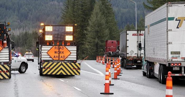 Trucks and other traffic is diverted off of eastbound Interstate 90 before Snoqualmie Pass, Wednesday, Jan. 18, 2017, in North Bend, Wash. An ice storm shut down parts of major highways and interstates Wednesday in Oregon and Washington state and paralyzed the hardest hit towns along the Columbia River Gorge with up to 2 inches of ice coating the ground in some places. In Washington state, I-90, the main highway connecting western and eastern Washington, was to remain closed over Snoqualmie Pass because of hazardous winter conditions. (AP Photo/Elaine Thompson)