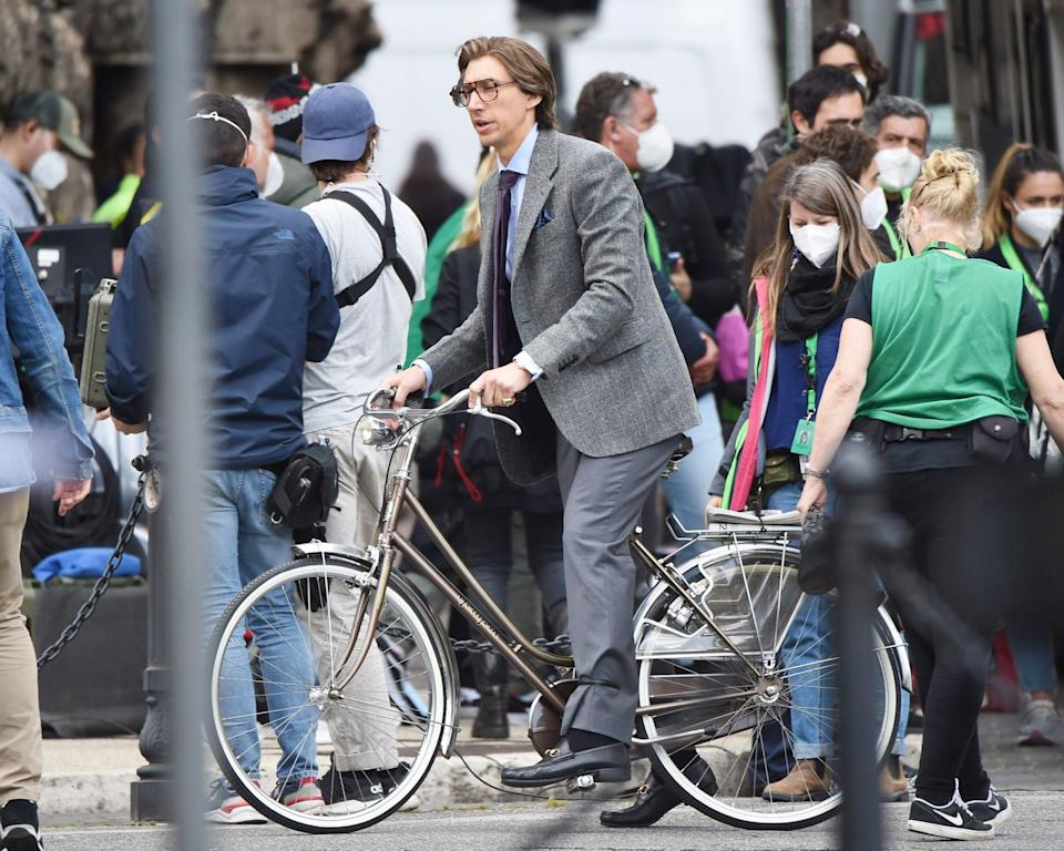 <p>Adam Driver rides a bike while filming <em>The Gucci House</em> on Thursday in Rome.</p>