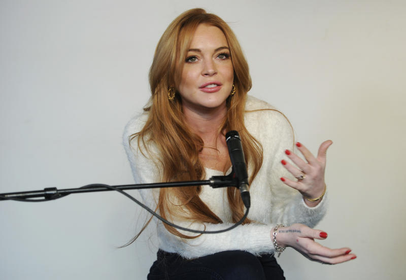 "Actress Lindsay Lohan addresses reporters at a news conference at the 2014 Sundance Film Festival, Monday, Jan. 20, 2014, in Park City, Utah. Producer Randall Emmett and Lohan announced the forthcoming production of a new film, ""Inconceivable,"" in which Lohan will star and co-produce. (Photo by Chris Pizzello/Invision/AP)"