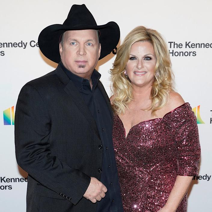 Garth Brooks and Trisha Yearwood arrive for the 42nd Annual Kennedy Awards Honors in Washington (Joshua Roberts / Reuters)