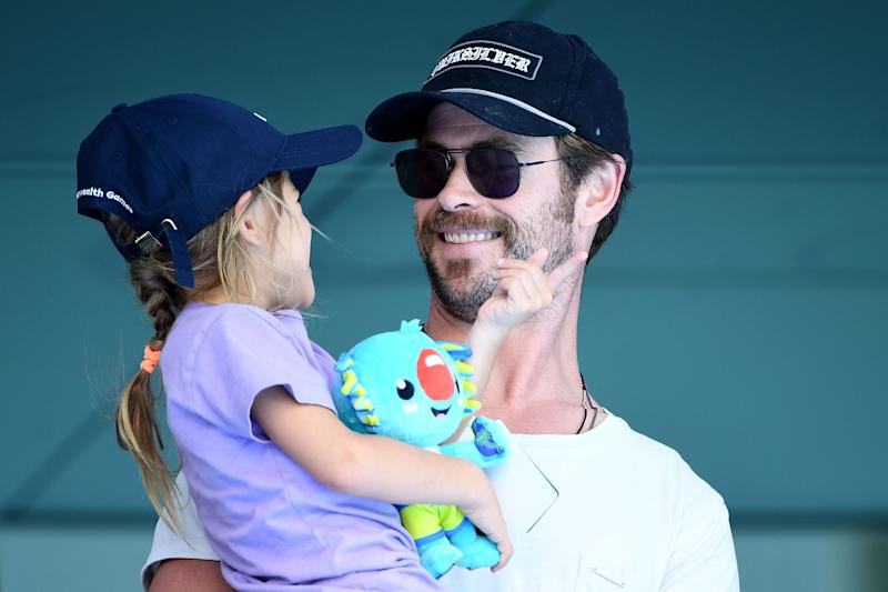 Actor Chris Hemsworth and daughter India Rose Hemsworth attend the swimming on day three of the Gold Coast 2018 Commonwealth Games at Optus Aquatic Centre. (Photo by Quinn Rooney/Getty Images)
