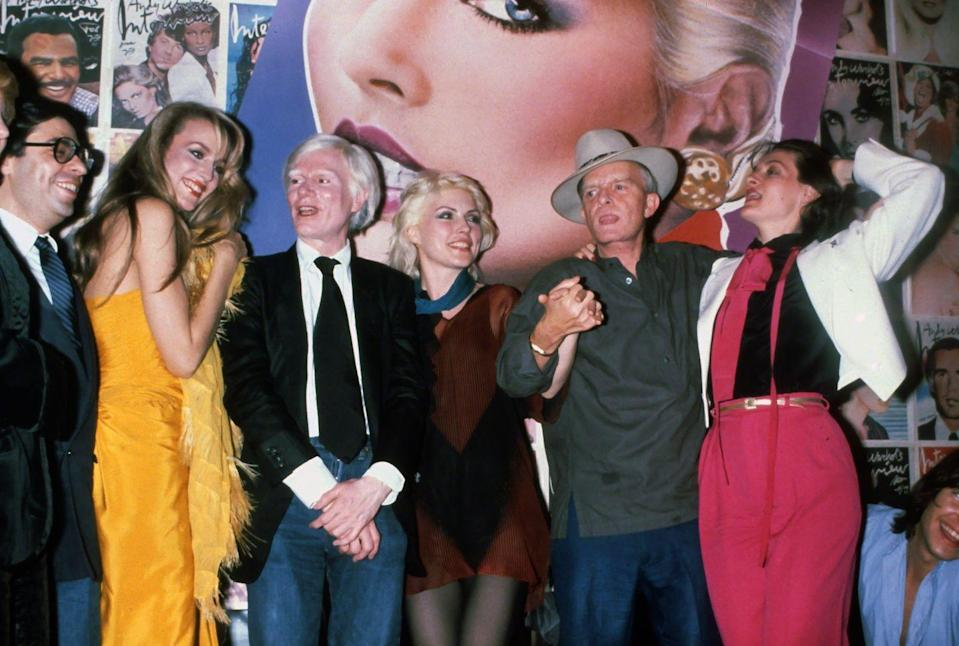 <p>Jerry Hall, Andy Warhol, Debbie Harry, Truman Capote, and Paloma Picasso arrive for a night at Studio 54 together in 1970.</p>