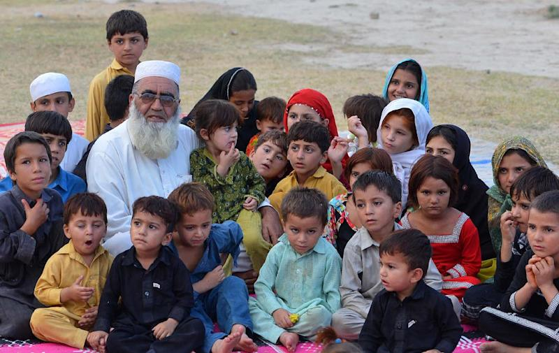 Gulzar Khan, who fled with his family following a military operation against militants in the North Waziristan tribal agency, pictured with some of his children in Bannu on July 11, 2014 (AFP Photo/A Majeed)