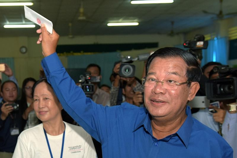 Cambodian Prime Minister Hun Sen is shown preparing to cast his ballot in June elections