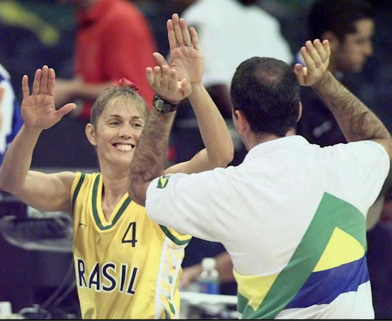 ATLANTA, GA - JULY 31: Brazil's Hortencia Marcari Oliva (L) is congratulated by assistant coach Sergio Duarte 31 July after their quarter-final defeat of Cuba in women's Olympic basketball 101-69 in the Georgia Dome. ELECTRONIC IMAGE (Photo credit should read ANTONIO SCORZA/AFP via Getty Images)