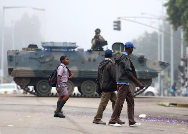<p>AN armed soldier patrols a street in Harare, Zimbabwe, Wednesday, Nov. 15, 2017. (Photo: AP) </p>