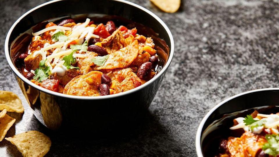 """<p>The addition of tortilla chips in this chicken chili recipe makes the dish an ideal meal for you and your guests to enjoy on a <a href=""""https://www.thedailymeal.com/recipe/game-day-recipes-football?referrer=yahoo&category=beauty_food&include_utm=1&utm_medium=referral&utm_source=yahoo&utm_campaign=feed"""" rel=""""nofollow noopener"""" target=""""_blank"""" data-ylk=""""slk:game day"""" class=""""link rapid-noclick-resp"""">game day</a>.</p> <p><a href=""""https://www.thedailymeal.com/recipes/tortilla-chicken-chili?referrer=yahoo&category=beauty_food&include_utm=1&utm_medium=referral&utm_source=yahoo&utm_campaign=feed"""" rel=""""nofollow noopener"""" target=""""_blank"""" data-ylk=""""slk:For the Tortilla Chicken Chili recipe, click here"""" class=""""link rapid-noclick-resp"""">For the Tortilla Chicken Chili recipe, click here</a>.</p>"""