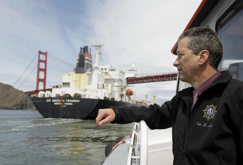 In this photo taken Wednesday April 25, 2012, Capt. Bruce A. Horton, president of the San Francisco Bar Pilots, watches as a tanker passes beneath the Golden Gate Bridge in San Francisco. Since the days of Mark Twain, the pilots have had it good. Thanks to political clout and highly specialized training, this cadre of 60 ship captains has for more than a century had control over guiding oil tankers and cargo ships in, out and around the San Francisco Bay.  (AP Photo/Eric Risberg)