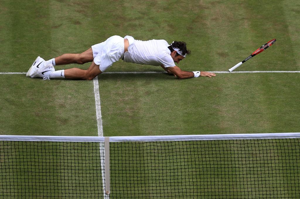 Switzerland's Roger Federer and five-time US Open champion halted his 2016 season after a five-set Wimbledon defeat (AFP Photo/Adam Davy)
