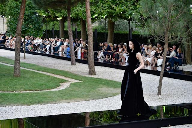 <p>The metallic, mirrored runway from the Givenchy fall 2018 couture collection set at the garden behind the Archives Nationales in Paris. (Photo: Getty Images) </p>