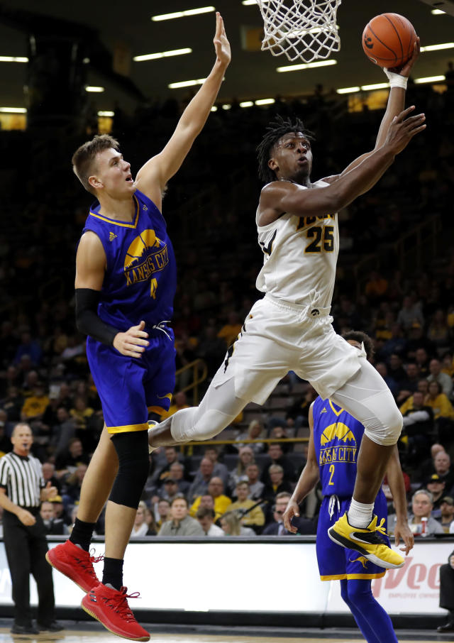 Iowa forward Tyler Cook drives to the basket past UKMC forward Danny Dixon, left, during the second half of an NCAA college basketball game, Thursday, Nov. 8, 2018, in Iowa City, Iowa. (AP Photo/Charlie Neibergall)