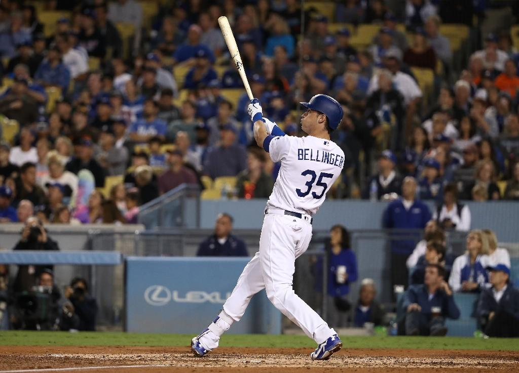 Cody Bellinger of the Los Angeles Dodgers watches the ball leave the ball park for his three-run home run, during the third inning against the San Francisco Giants, at Dodger Stadium in Los Angeles, California, on September 22, 2017 (AFP Photo/Victor Decolongon)