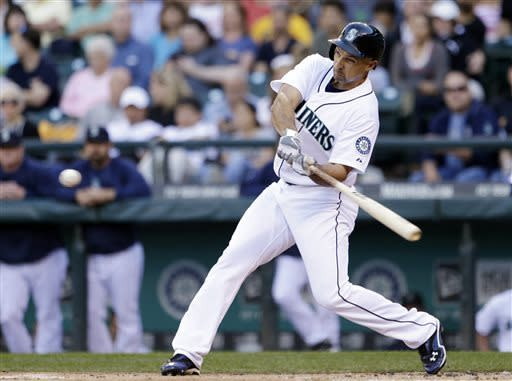 Seattle Mariners' Raul Ibanez swings on a home run against the Chicago White Sox in the first inning of a baseball game Tuesday, June 4, 2013, in Seattle. (AP Photo/Elaine Thompson)