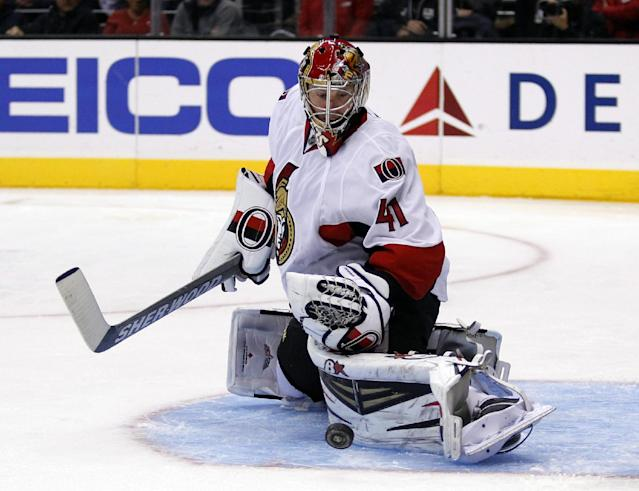 Ottawa Senators goalie Craig Anderson (41) makes a kick save against the Los Angeles Kings during the second period of their NHL hockey game, Wednesday, Oct. 9, 2013, in Los Angeles. (AP Photo/Alex Gallardo)