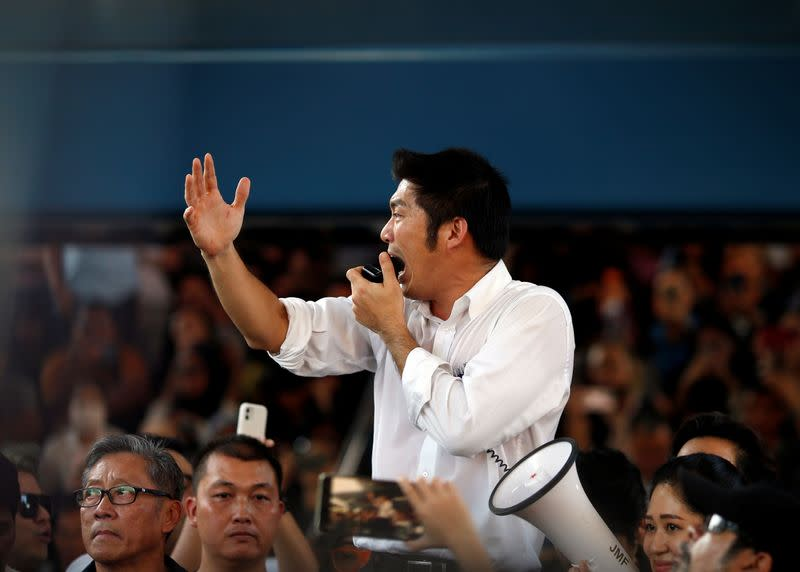 Juangroongruangkit of Thailand's progressive Future Forward Party talks to his supporters during an unauthorised flash mob rally in Bangkok