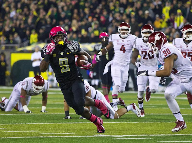 Oregon Ducks running back Byron Marshall (9), runs in a touchdown against the Washington State Cougars at Autzen Stadium in Eugene, Ore., Sat, Oct 19, 2013. (AP Photo/The Oregonian, Thomas Boyd)