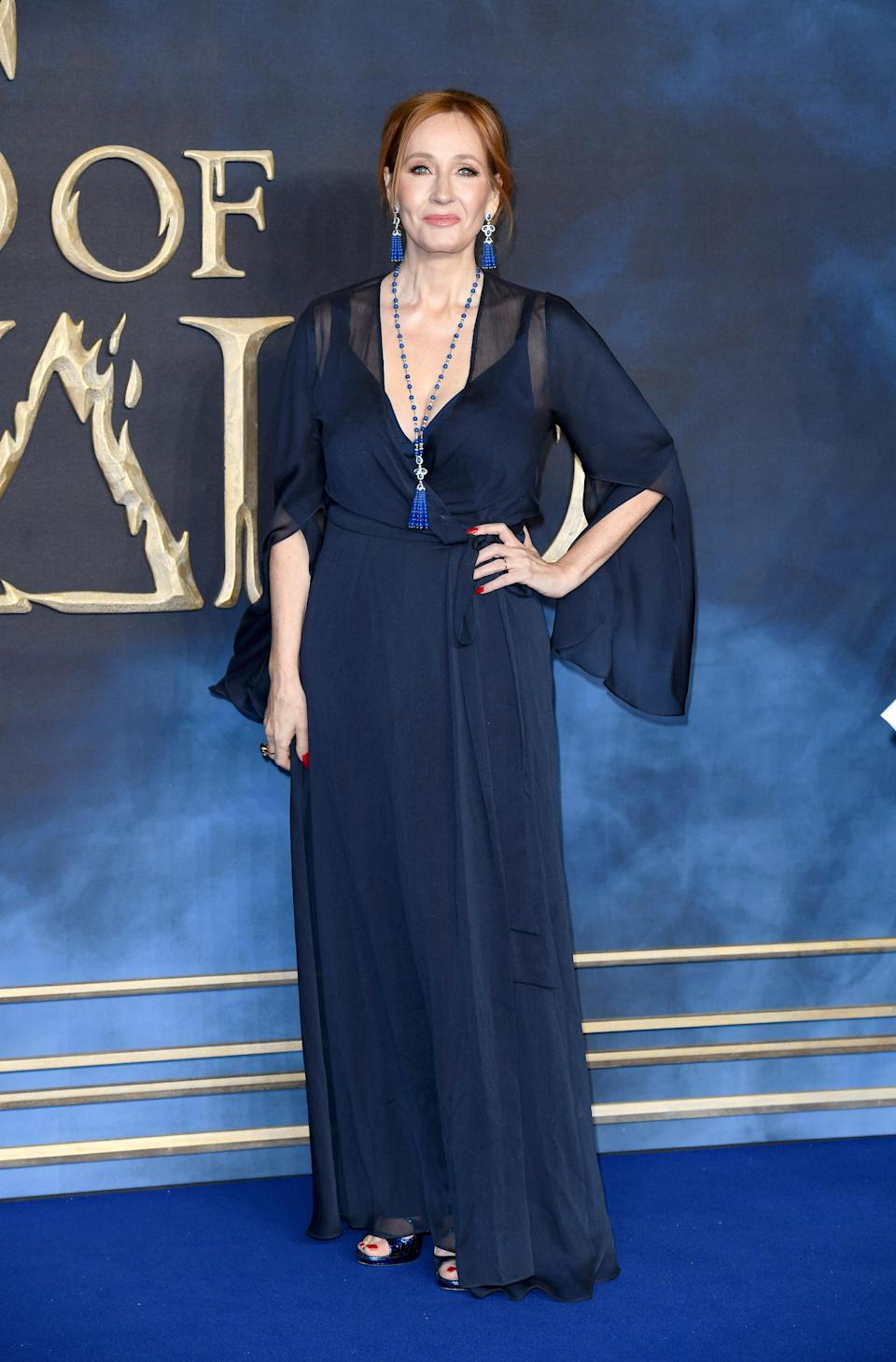 <p>The 'Harry Potter' author wore a floor-length navy gown at the UK premiere of 'Fantastic Beasts: The Crimes Of Grindelwald' at Cineworld Leicester Square in London. <em>[Photo: Getty]</em> </p>