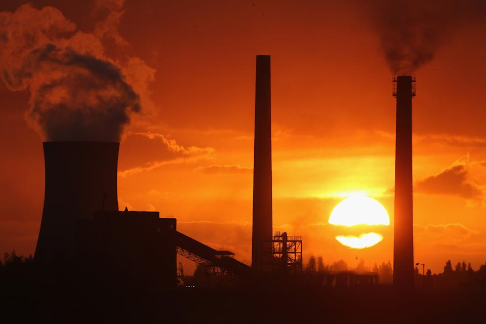 SCUNTHORPE, ENGLAND - OCTOBER 19:  The sun sets behind the Tata Steel processing plant at Scunthorpe which may make 1200 workers redundant on October 19, 2015 in Scunthorpe, England. Up to one in three workers at the Lincolnshire steel mill could lose their jobs alongside workers at other plants in Scotland. Tata Steel UK  is due to announce the Scunthorpe job losses this week.  (Photo by Christopher Furlong/Getty Images)