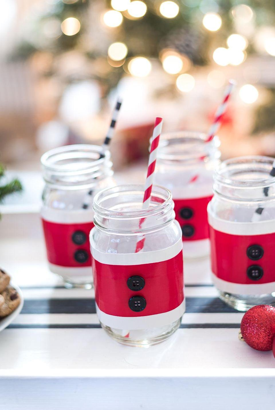"""<p>No matter what holiday drink your guests are sipping, these Santa suit Mason jar cozies will make it merrier.</p><p><strong>Get the tutorial at <a href=""""https://www.itallstartedwithpaint.com/mason-jar-santa-suit-cozy/"""" rel=""""nofollow noopener"""" target=""""_blank"""" data-ylk=""""slk:It All Started With Paint"""" class=""""link rapid-noclick-resp"""">It All Started With Paint</a>.</strong></p><p><a class=""""link rapid-noclick-resp"""" href=""""https://www.amazon.com/Duck-Brand-1265014-Inches-Single/dp/B002TOL428/ref=asc_df_B002TOL428/?tag=syn-yahoo-20&ascsubtag=%5Bartid%7C10050.g.2132%5Bsrc%7Cyahoo-us"""" rel=""""nofollow noopener"""" target=""""_blank"""" data-ylk=""""slk:SHOP RED DUCT TAPE"""">SHOP RED DUCT TAPE</a><br></p>"""