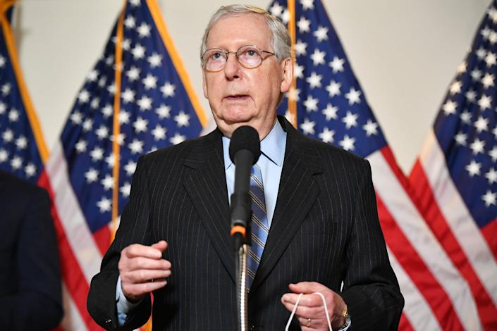 Mitch McConnell's challenger in the US Senate race has accused him of refusing to participate in debates moderated by women. (AFP via Getty Images)