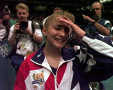 FILE - In this July 23, 1996, file photo, members of the media pursue USA's Shannon Miller, of Edmond, Ohio, after the U.S. women's national gymnastics team won the gold in the team competition at the Centennial Summer Olympic Games in Atlanta. (AP Photo/Amy Sancetta, File)