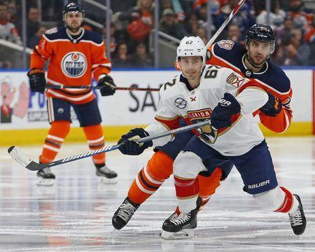 Jan 10, 2019; Edmonton, Alberta, CAN; Florida Panthers forward Denis Malgin (62) and Edmonton Oilers forward Tobias Rieder (22) look for a loose puck during the third period at Rogers Place. Mandatory Credit: Perry Nelson-USA TODAY Sports
