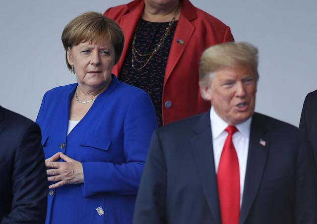 <p>German Chancellor Angela Merkel and President Trump attend the opening ceremony at the 2018 NATO Summit on July 11, 2018, in Brussels. (Photo: Sean Gallup/Getty Images) </p>