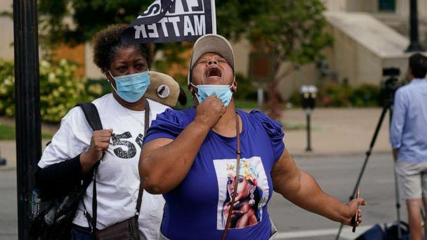 PHOTO: A woman reacts to news in the Breonna Taylor shooting, Sept. 23, 2020, in Louisville, Ky. (Darron Cummings/AP)