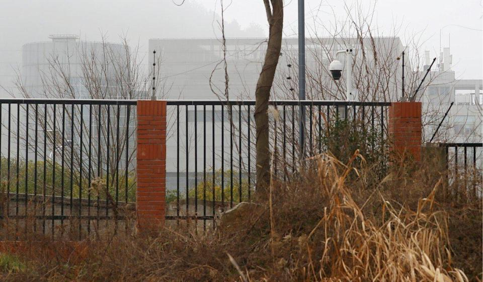 Wuhan Institute of Virology is seen behind a fence during the visit by the World Health Organization team tasked with investigating the origins of the coronavirus disease in Wuhan, China on February 3. Photo: Reuters