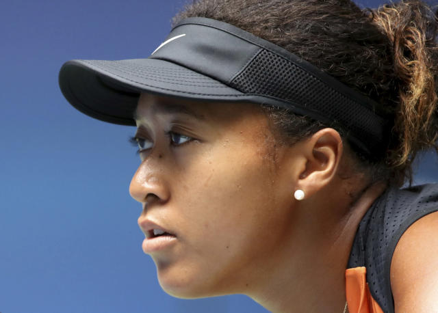 Naomi Osaka, of Japan, prepares for the serve from Anna Blinkova, of Russia, during the first round of the US Open tennis tournament Tuesday, Aug. 27, 2019, in New York. (AP Photo/Michael Owens)