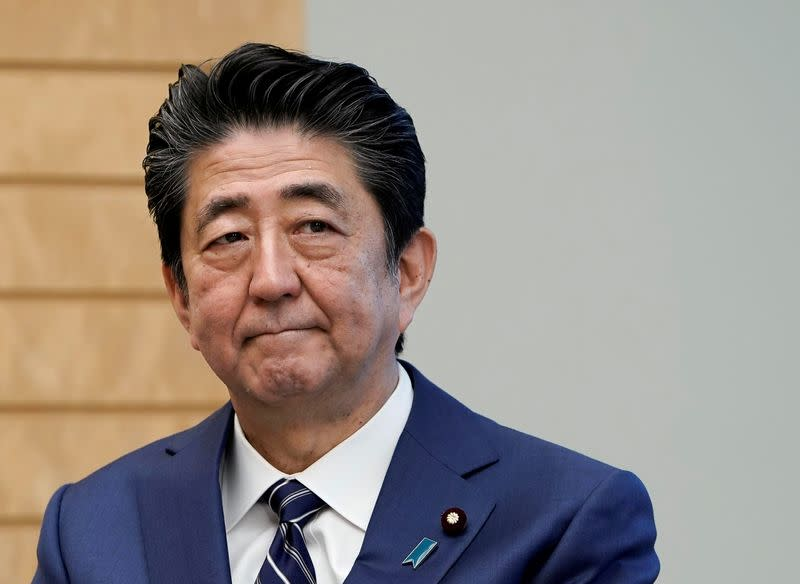 Japan's Abe vows to protect economy as virus heightens recession fears