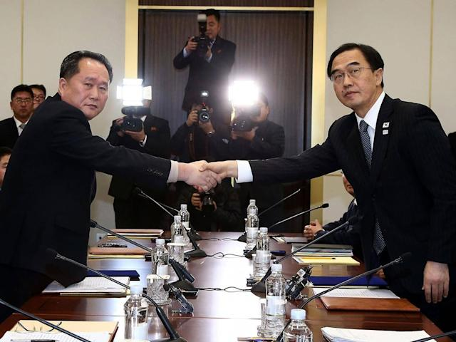 South Korean Unification Minister Cho Myoung-Gyon (R) shakes hands with the head of the North Korean delegation Ri Son-Gwon during talks this week (Getty)