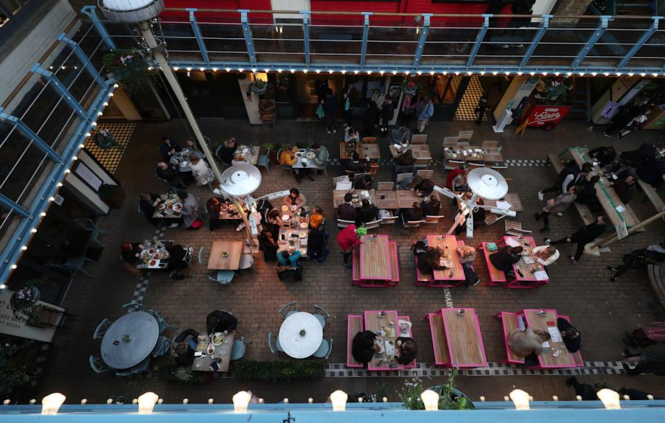 People enjoying outdoor dining in Kingly Court, London (PA Archive)