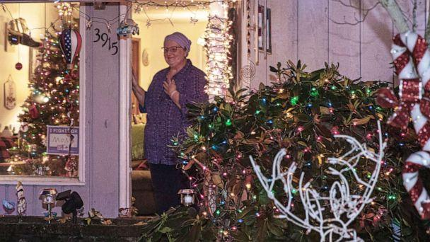 PHOTO: Teacher Laurie Burpee stands outside her Vancouver, Wash., house where her students surprised her with Christmas carols. (Courtesy Glen Erickson)