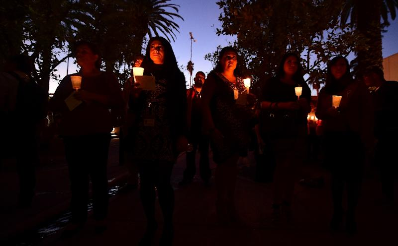 People gather at a candlelight vigil for those killed in the December 2, 2015 mass shooting in San Bernardino, California (AFP Photo/Frederic J. Brown)