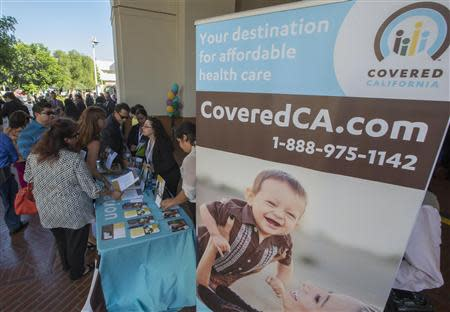 People sign up for health insurance information at a Covered California event which marks the opening of the state's Affordable Healthcare Act, commonly known as Obamacare, health insurance marketplace in Los Angeles, California, October 1, 2013. REUTERS/Lucy Nicholson